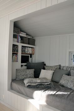 Cozy reading nook, looks like you could even snuggle up and watch a film. Scandinavian Retreat: July 2012
