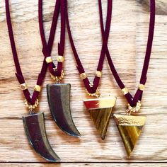 Pyrite & Tiger's Eye Pendants on Garnet Suede $28  www.meredithjackson.com #majdesigns #pendants #necklaces #jewelry #pyrite #tigerseye #arrow #tooth #horn #gold #silver #shoplocal #shopsmall #charlotte