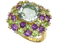 A fabulous and eye-catching cocktail ring with a central cushion cut green amethyst, surrounded by sparkling green peridots and contrasting purple amethysts.