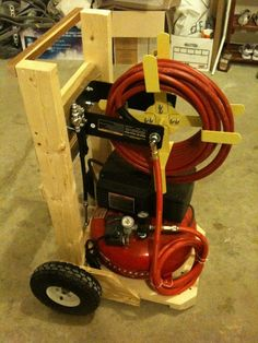 "Air Compressor Cart by Jzbowmannz -- Homemade air compressor cart intended to accommodate a Porter-Cable pancake air compressor. Constructed from wood and plywood. Equipped with 10"" tires. http://www.homemadetools.net/homemade-air-compressor-cart"