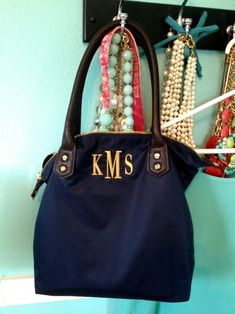 Navy Bag with monogram but not necessarily the exact one attached to the link.****************