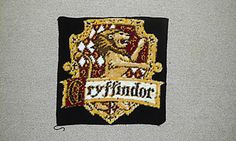 Gryffindor House Crest by Lee Mac. Free pattern on Ravelry at http://www.ravelry.com/patterns/library/gryffindor-house-crest