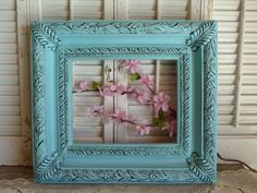 Vintage aqua blue ornate frame. This would be a great pop of color for your room.