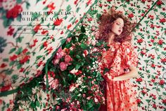 Posing against a vintage-looking wallpaper, Lindsey Wixson models Simone Rocha embroidered tulle dress