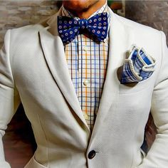 A fresh white blazer, with blue and yellow accents. #pocketsquare #classy