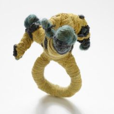 Ria Lins  Ring - wool, textile, embroidering thread, paint