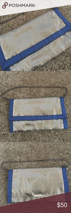 New BCBG $128 Silver Mesh Blue Clutch Purse Length is 9 1/2 inches, width is 5 1/2 inches. Blue material is cloth. Chain strap is not removable but can be tucked in to make a clutch. Two missing mesh points on back if purse, see last picture. BCBGMaxAzria Bags Clutches & Wristlets