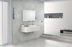 Bathroom with graffiti tile feature wall. Tile selection from Yun collection by Florina Ceramics.