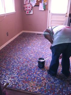 Brian putting the varnish on the floor. A year's worth of beer drinking and cap collecting is over...for now!