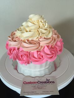 Smash cake. Pink ombré cake. This giant cupcake is layered in buttercream. Cupcake she's is make from fondant. Follow me on face book Custom Creations Sudbury