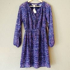 Blue & Pink Abstract Print Long Sleeve Dress Brand new with tags, size small, and in perfect condition. Forever 21 long sleeve dress, lined, and adjustable low v-neck. Elastic waist and arm cuffs. Please ask if you have any questions. Bundle and Save Forever 21 Dresses Long Sleeve