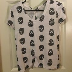 White Lilu tee with skulls and hearts White loose Lilu tee with black skulls and heart eyes. Also has a open slit down the back. Great condition! Lilu Tops Tees - Short Sleeve
