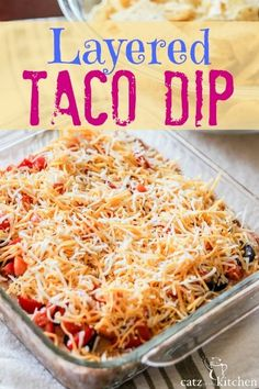 DELICIOUS! This dish is perfect for potlucks, baby shower spreads, taco nights, movie nights. It's little to no work at all---and always a hit on whatever table it's placed! Layered Taco Dip by @Catz in the Kitchen