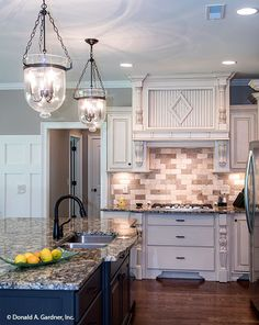 A faux-brick backsplash and custom trim accent this spacious kitchen. The Spotswood - Plan 1310. http://www.dongardner.com/house-plan/1310/the-spotswood. #Kitchen #Spacious #HomePlan