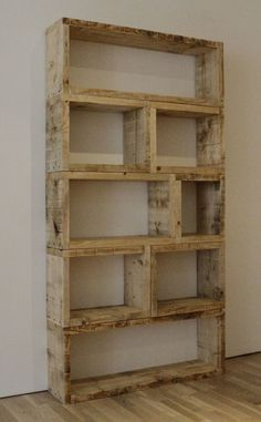 Recycled...Bookshelf made of pallets or old wood pieces ~ I'd probably paint this seafoam green...