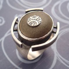 Ring   Chuck Domitrovich.  Sterling silver and a stone found on the beach.