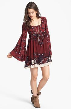 Floral print burgundy mini dress with bell sleeves, tan ankle boots, and multi-strand necklace