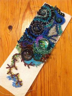 Embroidery Bracelets Ideas Beaded bracelet in progress, by Charlotte Clark - Roxwell Beads Bead Embroidery Tutorial, Bead Embroidery Patterns, Beading Patterns, Embroidery Floss Bracelets, Bead Embroidery Jewelry, Beaded Embroidery, Seed Bead Jewelry, Beaded Jewelry, Beaded Bracelet