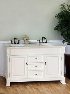 The <b>Helena Double Vanity</b> features a charming, traditional design with its antique brass hardware, rubbed edge finish, and its beveled edges and faces.