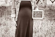 Focusing on the mama's belly and the baby's due date creates a fun photo for scrapbooks and pregnancy announcements. The chalkboard prop and black-and-white image create a retro feel that will stand the test of time. Source: Katie Church Photography
