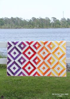 quilting in warm-toned strips create a stunning ombre effect Strip Quilts, Quilt Blocks, Jellyroll Quilts, Batik Quilts, Quilting Fabric, Pattern Blocks, Twin Quilt Pattern, Block Patterns, Rainbow Quilt