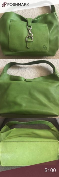 Dooney & Bourke large satchel bag Gorgeous Apple Green large Belvedere logo lock bag. It has a few marks on the leather that I have not tried to clean. 2 red marks on interior leather (see pic) that cannot be seen when carrying it. Slight soil mark on bottom of fabric inside purse. This is a perfect addition to your spring wardrobe!! Dooney & Bourke Bags Satchels