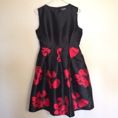 Floral dress Beautiful and perfect dress for the holiday black dress with red floral print. Size large but fits a size 6/8. Dresses Midi