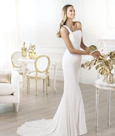 Pronovias 2014 FASHION / Lamber Style Wedding dress with asymmetric draped bodice and flared skirt.