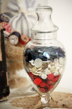 Apothecary jar filled with layers of red, white and blue buttons   Creative vintage 4th of July decor   Thoughts from Alice