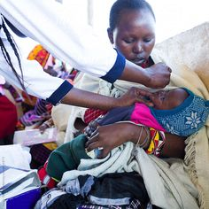 Stock photo of Baby receiving polio vaccine. by hughsitton Kenya, Baby Photos, Clinic, Africa, Medical, The Unit, Baby Pictures, Toddler Photos, Babies Photography