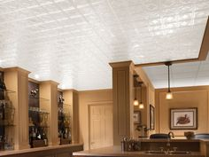 Chrome-plated Armstrong's Metallaire drop panel ceiling reflects a sophisticated aesthetic in this basement's bar. Metal Ceiling Tiles, Metal Walls, Ceiling Decor, Ceiling Design, Ceiling Ideas, Touchless Kitchen Faucet, Basement Remodeling, Basement Ideas, Metal Tins