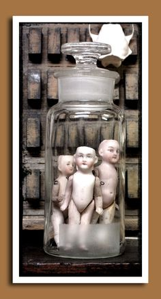 doll parts in the summer glass water pitcher for Halloween!