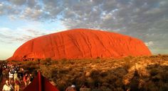 Uluru or Ayers Rock in Australia is one of the world's great natural wonders. The rock is at its visual best at sunrise and sunset. Most of the travelers like to climb the rock by using an ancient aboriginal trail. Ayers Rock Australia, Australian Icons, Travel Icon, Seven Wonders, Tourist Places, Australia Travel, Visit Australia, Natural Wonders, World Heritage Sites
