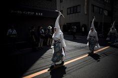 Heron-hooded dancers parade during the Sanja Matsuri festival in Tokyo.