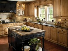 Rustic wood cabinets and kitchen island create an elegant and cozy kitchen that . Rustic wood cabinets and kitchen island create an elegant and cozy kitchen that is signature of country design. Kitchen Island Decor, Modern Kitchen Island, Cozy Kitchen, Home Decor Kitchen, Kitchen Styling, New Kitchen, Home Kitchens, Kitchen Ideas, Log Cabin Kitchens