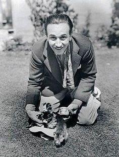 Walt Disney with some kittens