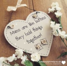 This gorgeous heart plaque would make a lovely gift for any mum and also a fabulous addition to any home… This wooden heart shaped plaque is painted in a pretty pale mushroom colour with the words 'Mums are like buttons, they hold things together' written in a 'shaker' style handwriting. With additional details such as …