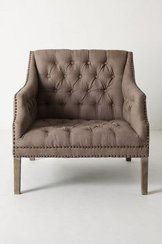 The nailhead detail + oversized dimensions makes a perfect library chair.