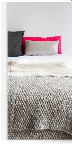 Loving the neutral creams and greys against the hot pink cushion. Image Via: Britta Nickel