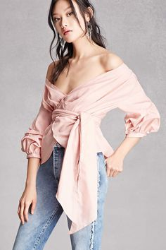 A woven off-the-shoulder top featuring a drapey wrap design, ruched 3/4 sleeves, and a curved hem. This is an independent brand and not a Forever 21 branded item.