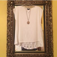 NWT- White sleeveless T Shirt w/ Lace Back White sleeveless T Shirt with Lace strip. Leave open or button together for a more fitted look. Love Tops Blouses