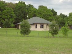 """Horse Property for Sale in  Columbia County in Florida. This wonderful home was built in 2007 to the """"Energy Star"""" code with icynene insulation, double pane windows, & gas fireplace. This incredible property is on 8.49 acres that are fenced with barbed wire and wood fencing. There are pear, apple, peach, and fig trees, plus blueberries & blackberries on the property as well. The original owner was from S. Fl and lived thru Hurricane Andrew so the Master Bedroom Closet is also a Hurricane…"""