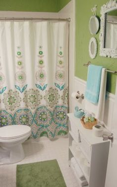 Adorable bathroom colors... love the storage shelf
