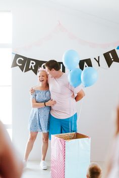 Cute gender reveal with box and balloons