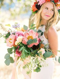 This bride clearly loves flowers. A lot. Not only is she wearing a lavish floral crown, but she is also carrying a bouquet that probably required extra training at the gym. When you want to make a big statement, use plenty of peonies and pair them with large greenery, such as these silver dollar eucalyptus leaves.