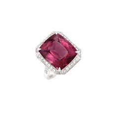 White Gold, Pink Tourmaline and Diamond Ring One modified cushion-shaped brilliant-cut pink tourmaline ap. 12.00 cts., 34 round & 8 tapered baguette diamonds ap. .80 ct., ap. 5.3 dwts. Size 6 1/4.