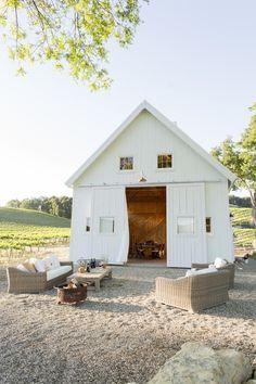 Converted white barn - gotta' love the board & batten siding and big sliding barn doors.