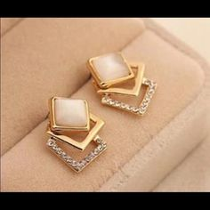 Sparking Rhinestone Square Opal Stud Earrings Enjoy these fun Sparking Rhinestone Geometry Square Opal Stud Earrings. Perfect to add to your costume jewelry collection. Brand new! Jewelry Earrings
