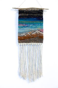 """Inspiration! This one-of-a-kind wall hanging was handwoven on a lap loom using wool, yarn (including reclaimed), and Pendleton blanket scraps. Tied to found driftwood and ready to hang. Made in Portland, Oregon. 2014.8.5"""" x 25"""""""