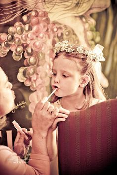 Flower girl getting ready for a wedding at Chateau Morrisette Winery in the Blue Ridge Mountains of Virginia.
